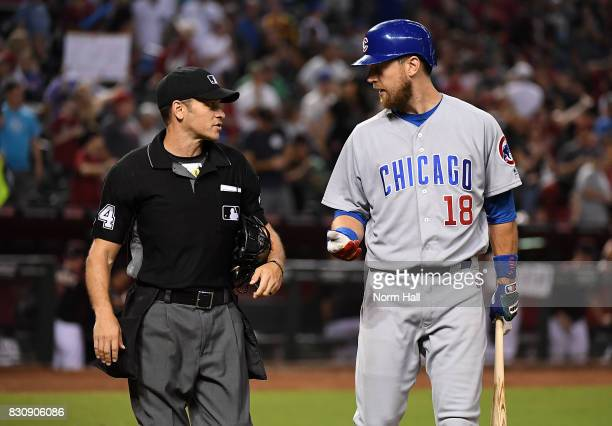 Kris Bryant the Chicago Cubs has a few words for home plate umpire Mark Wegner after a third called strike to the end the game against the Arizona...
