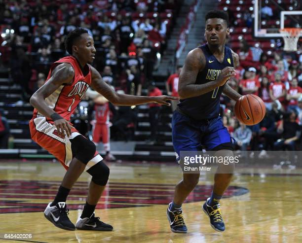 Kris Clyburn of the UNLV Rebels guards Marcus Marshall of the Nevada Wolf Pack during their game at the Thomas Mack Center on February 25 2017 in Las...