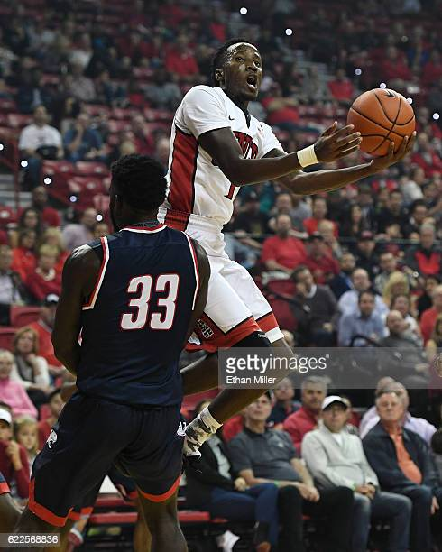 Kris Clyburn of the UNLV Rebels is fouled as he drives to the basket by Josh Ajayi of the South Alabama Jaguars during their game at the Thomas Mack...