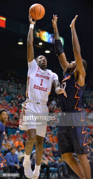 Kris Clyburn of the UNLV Rebels shoots against Leron Black of the Illinois Fighting Illini during their game at the MGM Grand Garden Arena on...
