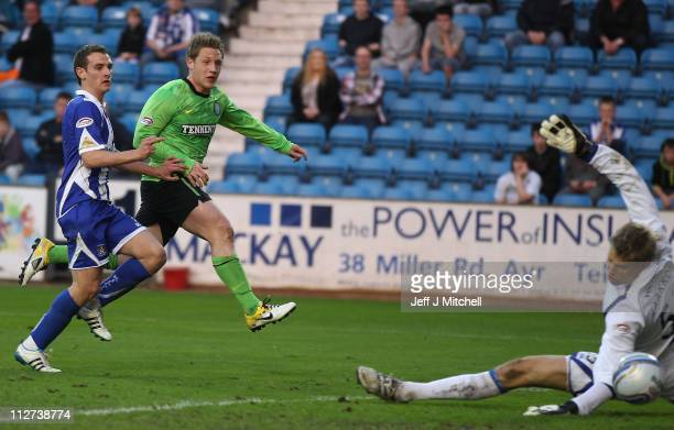 Kris Common of Celtic scores during the Clydesdale Bank Premier League match between Kilmarnock and Celtic at Rugby Park on April 20 2011 in...