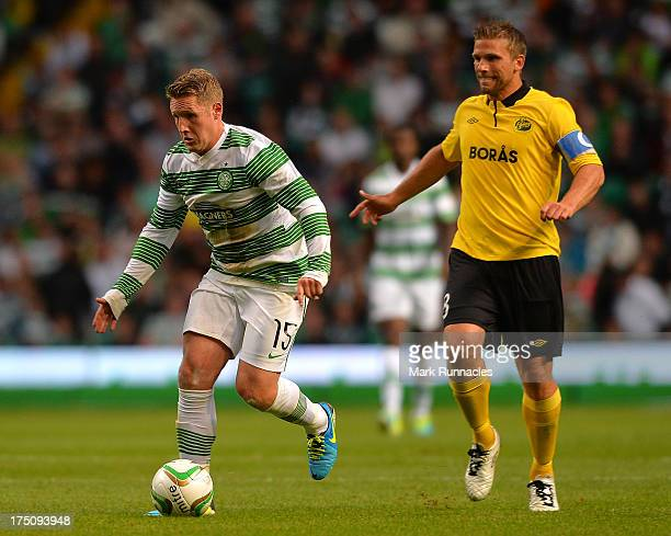 Kris Commons of Celtic beats Anders Svensson of Elfsborg during the UEFA Champions League Third Qualifying Round First Leg match between Celtic and...