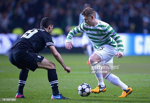Kris Commons of Celtic competes with Leonardo Bonucci of Juventus during the UEFA Champions League Round of 16 first leg match between Celtic and...
