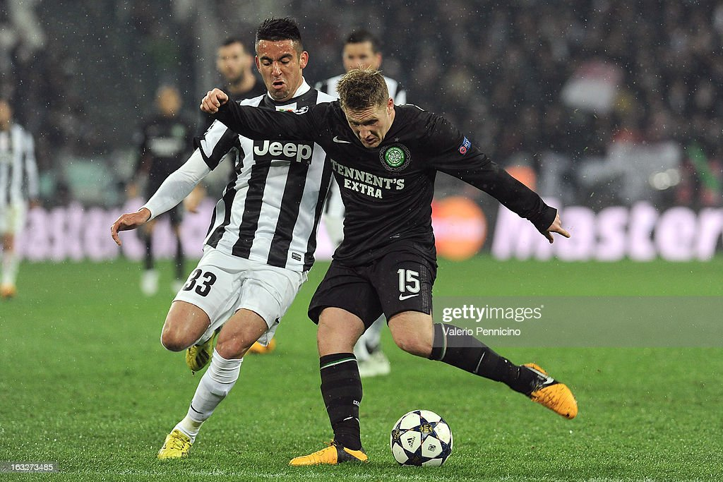 Kris Commons (R) of Celtic is challenged by Mauricio Isla of Juventus during the UEFA Champions League round of 16 second leg match between Juventus and Celtic at Juventus Arena on March 6, 2013 in Turin, Italy.