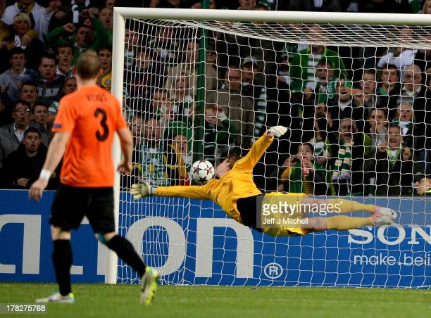 Kris Commons of Celtic puts the ball past Aleksandr Mokin of Shakhter Karagandy to score during the UEFA Champions League Playoff second leg match...