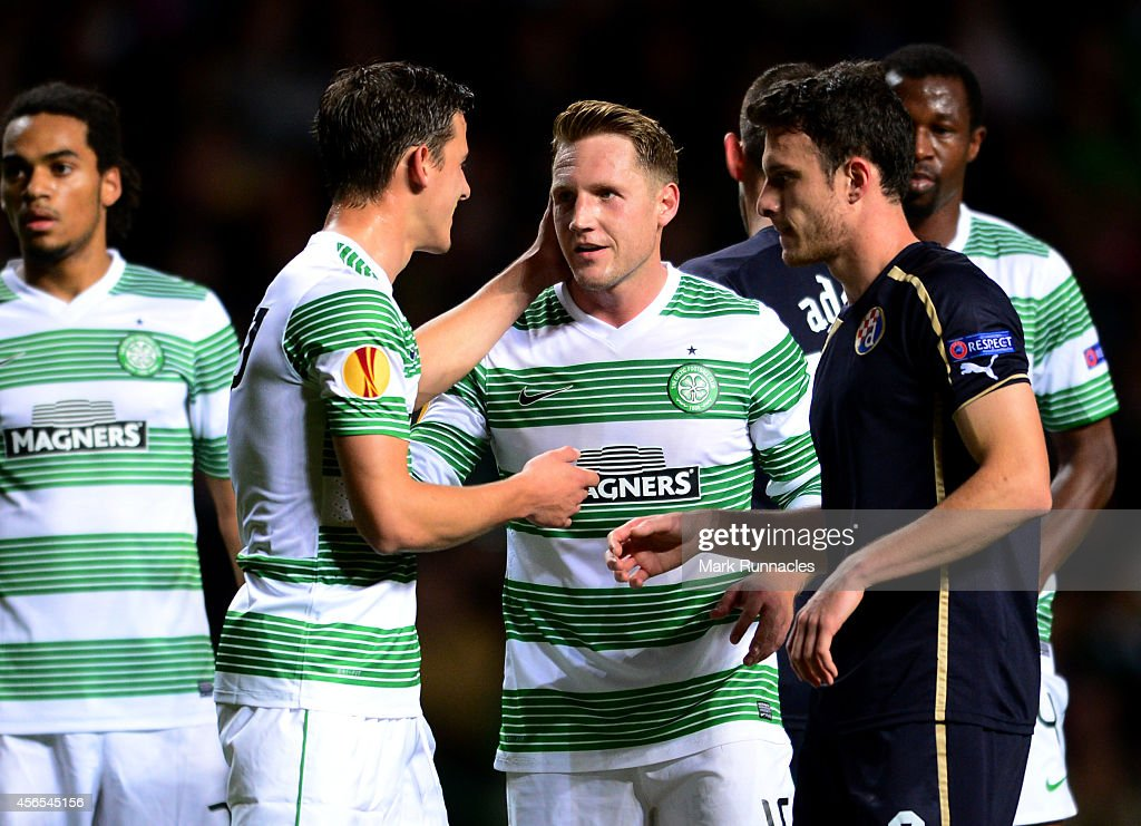 Kris Commons of Celtic receives a pat on the check for team mate Alexander Tonev during the 1-0 victory over Dinamo Zagreb during the UEFA Europa League group D match between Celtic and Dinamo Zagreb at Celtic Park on October 02, 2014 in Glasgow Scotland.