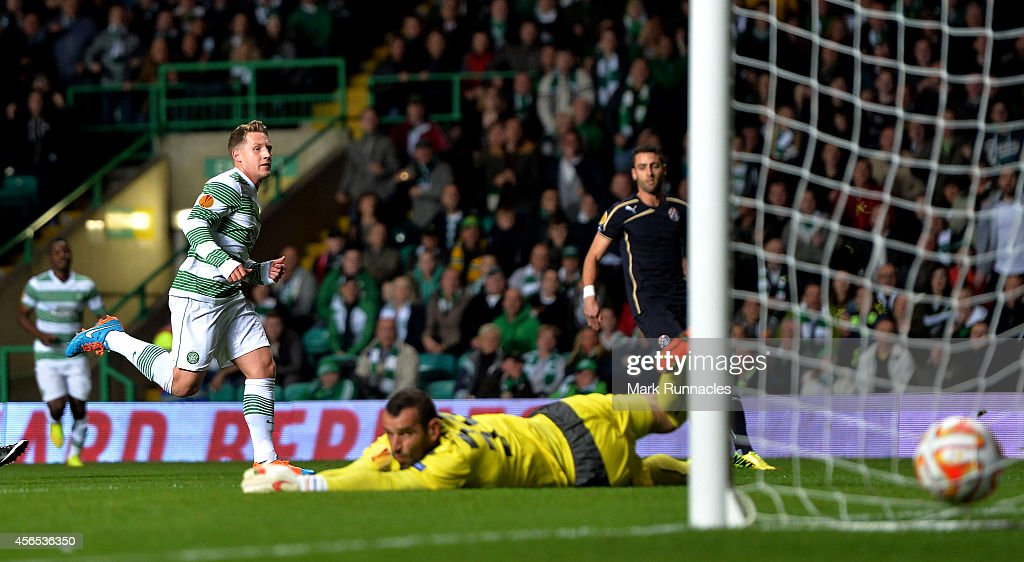 Kris Commons of Celtic scores the first goal during the UEFA Europa League group D match between Celtic and Dinamo Zagreb at Celtic Park on October 02, 2014 in Glasgow, Scotland.