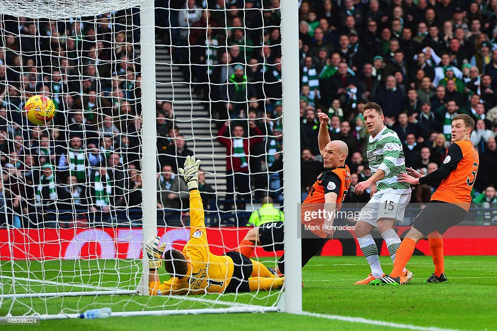 Kris Commons of Celtic scores the opening goal during the Scottish League Cup Final between Dundee United and Celtic at Hampden Park on March 15, 2015 in Glasgow, Scotland.