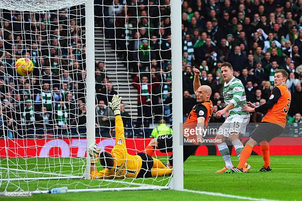 Kris Commons of Celtic scores the opening goal during the Scottish League Cup Final between Dundee United and Celtic at Hampden Park on March 15,...