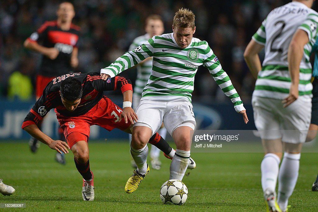 Kris Commons of Celtic tackles Enzo Perez of SL Benfica during the UEFA Champions League Group G match between Celtic and SL Benfica at Celtic Park on September 19, 2012 in Glasgow, Scotland.