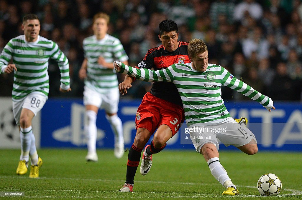 Kris Commons of Celtic tackles Enzo Perez of SL Benfica during the Champions League UEFA Champions League match between Celtic and SL Benfica at Celtic Park on September 19, 2012 in Glasgow,Scotland.