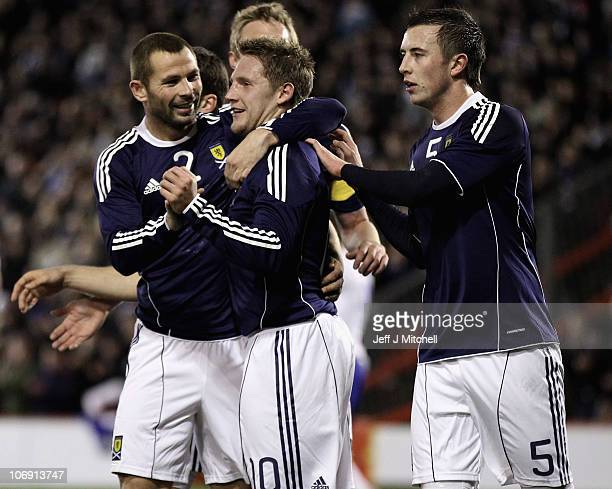Kris Commons of Scotland celebrates with Phil Bardsley and Danny Wilson after scoring during the international friendly match between Scotland and...