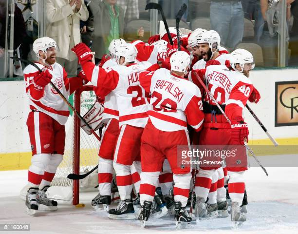 Kris Draper and the Detroit Red Wings celebrate after defeating the Dallas Stars in game six of the Western Conference Finals of the 2008 NHL Stanley...
