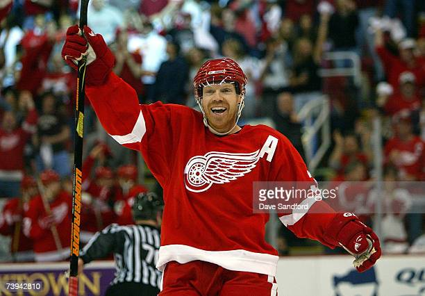 Kris Draper of the Detroit Red Wings celebrates teammate Chris Chelios' goal scored against the Calgary Flames during game 5 of their 2007 NHL...