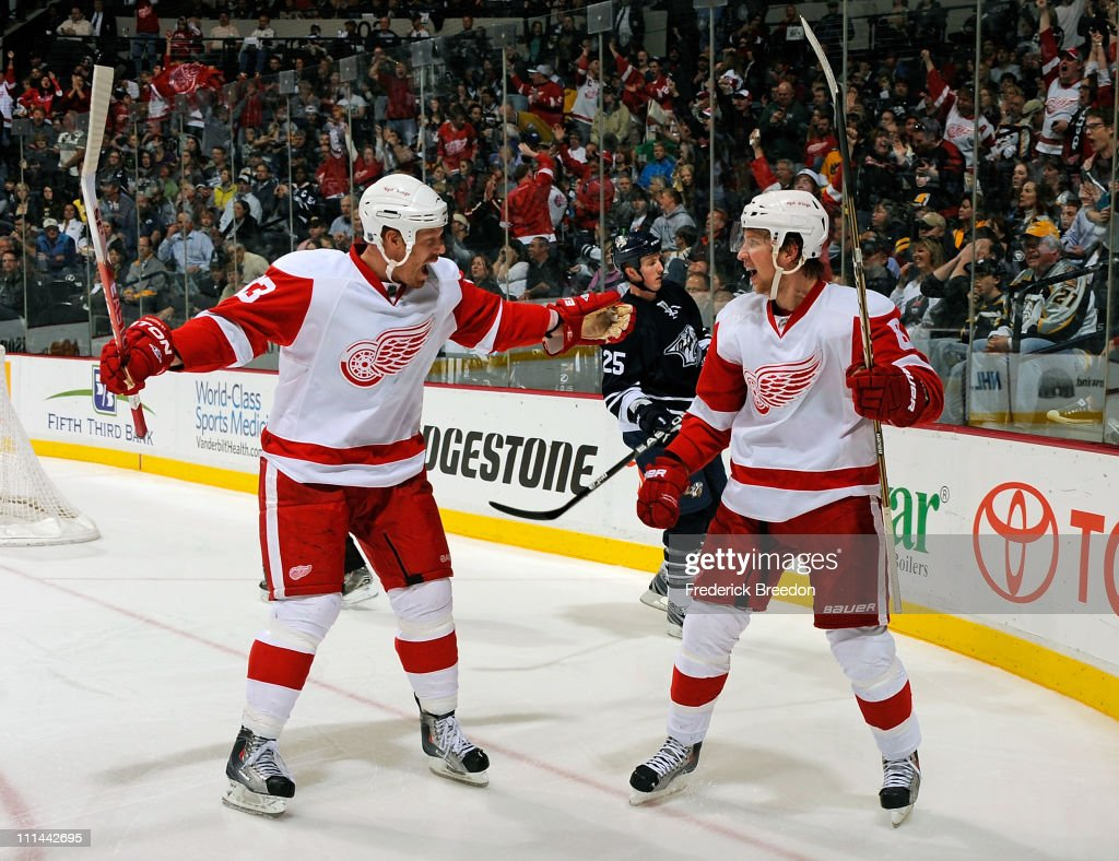 Kris Draper #33 of the Detroit Red Wings congratulates teammate Justin Abdelkader #8 on scoring a goal against the Nashville Predators on April 2, 2011 at the Bridgestone Arena in Nashville, Tennessee.