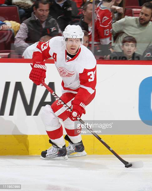 Kris Draper of the Detroit Red Wings contrls the puck on the ice during an NHL game against the Carolina Hurricanes on April 6, 2011 at RBC Center in...