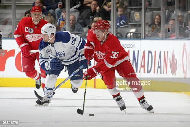 Kris Draper of the Detroit Red Wings handles the puck against the Toronto Maple Leafs at the Air Canada Centre on November 7, 2009 in Toronto, Canada.