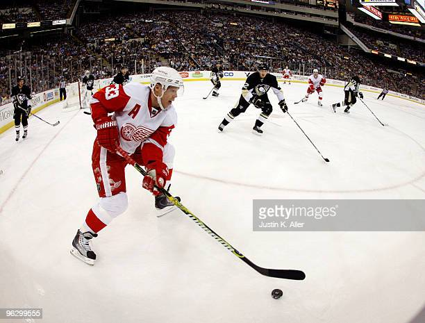 Kris Draper of the Detroit Red Wings handles the puck along the boards against the Pittsburgh Penguins in the second period at Mellon Arena on...