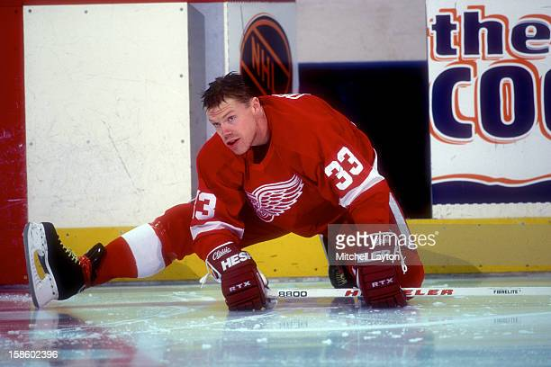 Kris Draper of the Detroit Red Wings looks on before a hockey game against the Washington Capitals on January 13, 1996 at USAir Arena in Landover,...