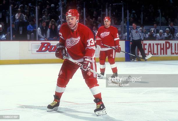 Kris Draper of the Detroit Red Wings looks on during a hockey game against the Washington Capitals on January 13, 1996 at USAir Arena in Landover,...