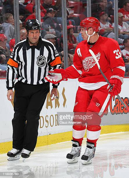 Kris Draper of the Detroit Red Wings questions referee Paul Devorski about a call in a game against the Los Angeles Kings on March 9, 2011 at the Joe...