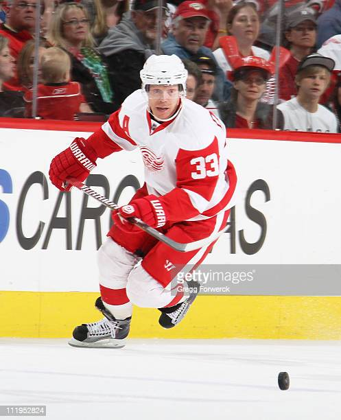 Kris Draper of the Detroit Red Wings skates for a loose puck during an NHL game against the Carolina Hurricanes on April 6, 2011 at RBC Center in...