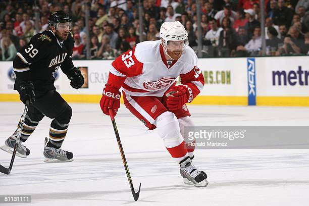 Kris Draper of the Detroit Red Wings skates for the puck against Joel Lundqvist of the Dallas Stars during game four of the Western Conference Finals...