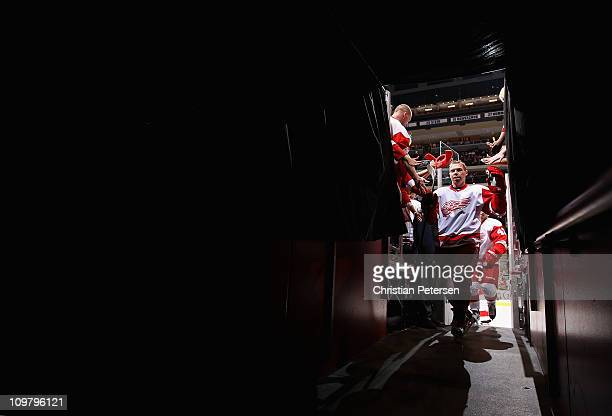 Kris Draper of the Detroit Red Wings skates off the ice following warm ups to the NHL game against the Phoenix Coyotes at Jobing.com Arena on March...