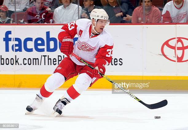 Kris Draper of the Detroit Red Wings skates the puck up ice against the Phoenix Coyotes on October 22, 2009 at Jobing.com Arena in Glendale, Arizona.