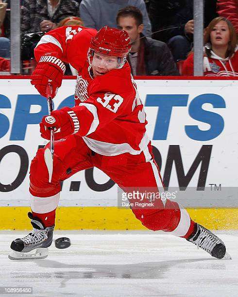 Kris Draper of the Detroit Red Wings takes a shot during an NHL game against the Nashville Predators at Joe Louis Arena on February 9, 2011 in...