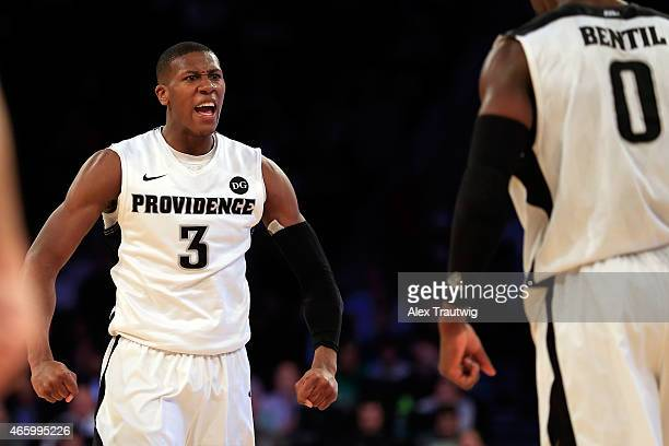 Kris Dunn celebrates with Ben Bentil of the Providence Friars against the St John's Red Storm during a quarterfinal game of the Big East basketball...