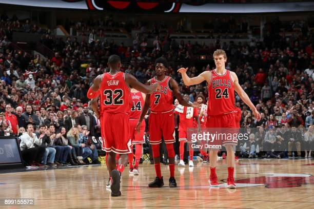 Kris Dunn Justin Holiday and Lauri Markkanen of the Chicago Bulls react during game against the New York Knicks on December 27 2017 at the United...