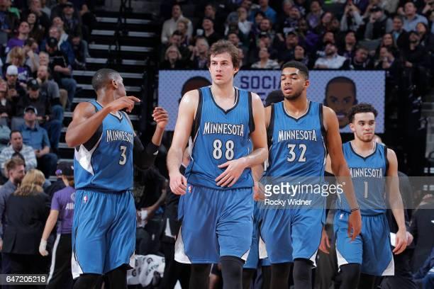 Kris Dunn Nemanja Bjelica KarlAnthony Towns and Tyus Jones of the Minnesota Timberwolves face the Sacramento Kings on February 27 2017 at Golden 1...