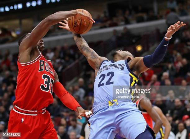 Kris Dunn of the Chicago Bulls blocks a shot by Xavier RathanMayes of the Memphis Grizzlies but is called for a foul at the United Center on March 7...