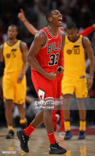 Kris Dunn of the Chicago Bulls celebrates after hitting a shot late in the game againsst the Utah Jazz at the United Center on December 13 2017 in...