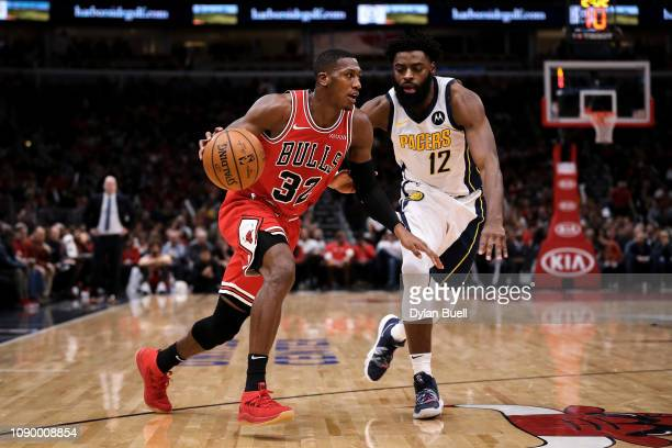 Kris Dunn of the Chicago Bulls dribbles the ball while being guarded by Tyreke Evans of the Indiana Pacers in the third quarter at the United Center...