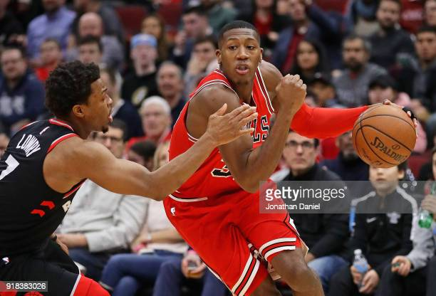 Kris Dunn of the Chicago Bulls drives around Kyle Lowry of the Toronto Raptors at the United Center on February 14 2018 in Chicago Illinois The...