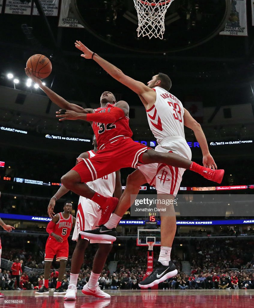 Houston rockets v chicago bulls kris dunn 32 of the chicago bulls drives between ryan anderson 33 and clint voltagebd Image collections