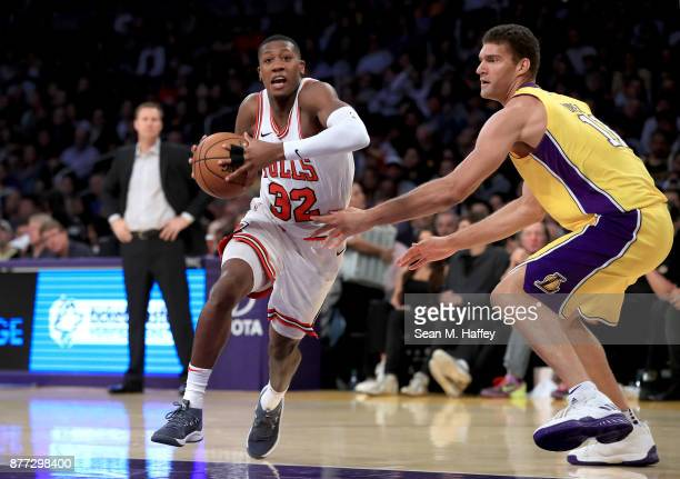 Kris Dunn of the Chicago Bulls drives past Brook Lopez of the Los Angeles Lakers during the first half of a game at Staples Center on November 21...