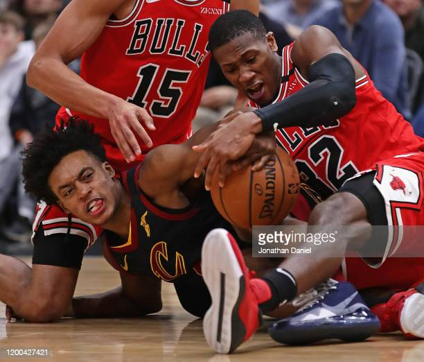 Kris Dunn of the Chicago Bulls forces a jump ball with Collin Sexton of the Cleveland Cavaliers at the United Center on January 18 2020 in Chicago...