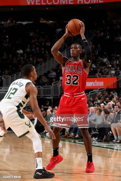 Kris Dunn of the Chicago Bulls handles the ball against the Milwaukee Bucks during a preseason game on October 3 2018 at Fiserv Forum in Milwaukee...
