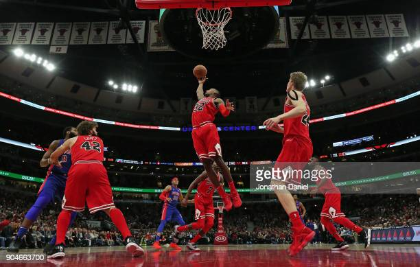 Kris Dunn of the Chicago Bulls rebounds against the Detroit Pistons at the United Center on January 13 2018 in Chicago Illinois The Bulls defeated...