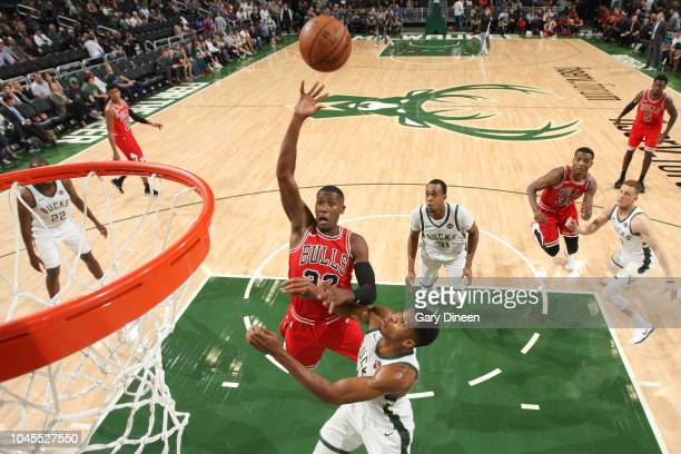 Kris Dunn of the Chicago Bulls shoots the ball against the Milwaukee Bucks during a preseason game on October 3 2018 at Fiserv Forum in Milwaukee...