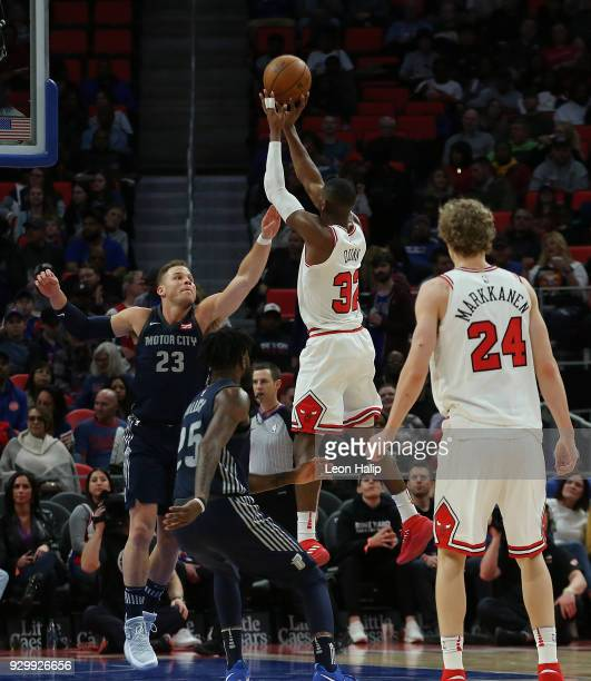 Kris Dunn of the Chicago Bulls shoots the ball over Blake Griffin of the Detroit Pistons during the first half of the game at Little Caesars Arena on...