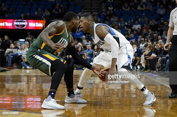 Kris Dunn of the Minnesota Timberwolves dribbles the ball against Shelvin Mack of the Utah Jazz during the game on January 7 2017 at the Target...