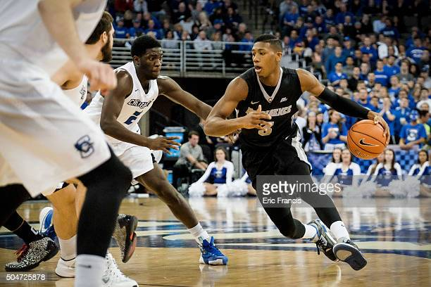 Kris Dunn of the Providence Friars drives past Khyri Thomas of the Creighton Bluejays during their game at CenturyLink Center on January 12 2016 in...