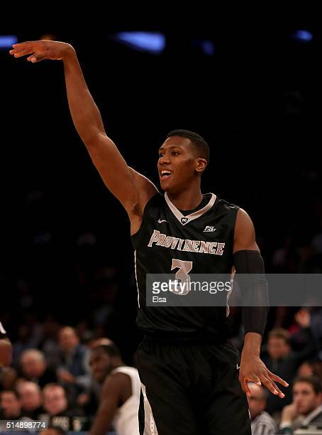 Kris Dunn of the Providence Friars follows through on a three point shot in the first half during the semifinals of the Big East Basketball...