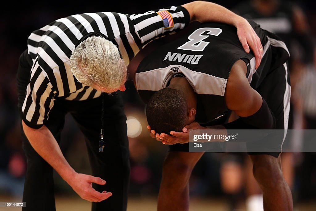 Kris Dunn #3 of the Providence Friars reacts after getting hit in the head against the Villanova Wildcats during a semifinal game of the Big East basketball tournament at Madison Square Garden on March 13, 2015 in New York City.