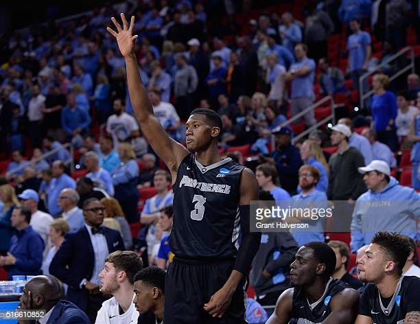 Kris Dunn of the Providence Friars salutes the fans as they chant his name in the last minute of the game against the North Carolina Tar Heels in the...
