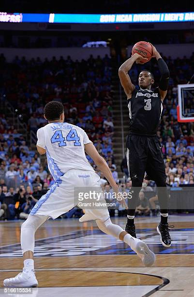 Kris Dunn of the Providence Friars shoots against Justin Jackson of the North Carolina Tar Heels in the second half during the second round of the...